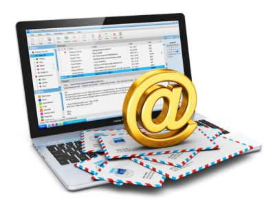 Creative abstract e-mail and internet web communication office business work concept: modern metal laptop or notebook computer PC with email client software program and heap of airmail letter envelopes with shiny golden AT symbol isolated on white background